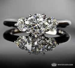 0.76ct diamond in center of three-stone ring