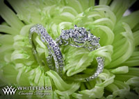 Clara Ashley with custom wedding band set flower