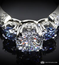 1.048ct diamonds with blue stones in 3 stone ring