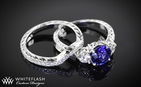 1_49ct blue sapphire with _50ctw side stones, hand engraved palladium