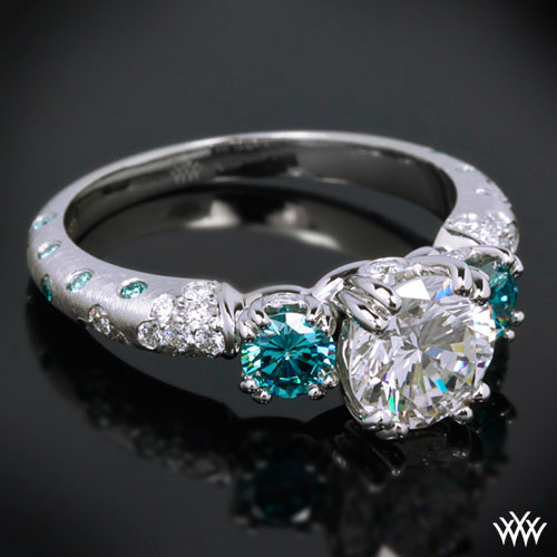 3 stone engagement ring with two blue side-stones