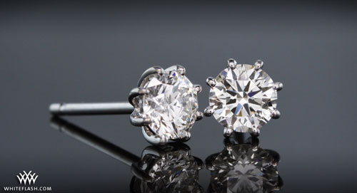 Four prong basket diamond earrings