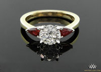 custom round and pear ruby three stone ring