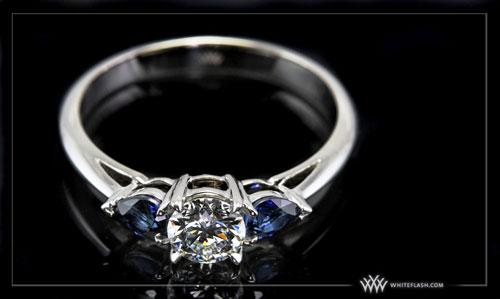 custom round and pear sapphire three stone ring