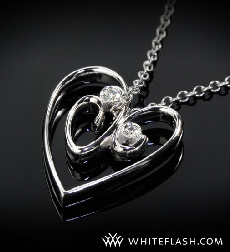 heart shaped pendant with 2 diamonds