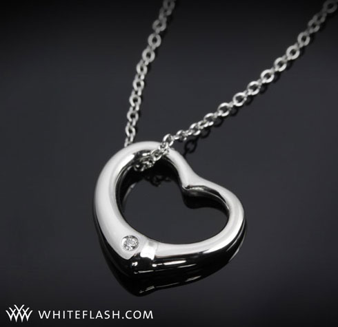 heart shaped pendant with diamonds