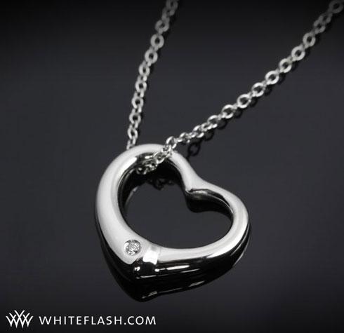 heart shaped pendant with diamonds