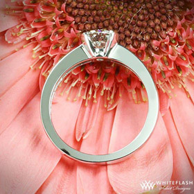 keystone solitaire engagement ring on flower