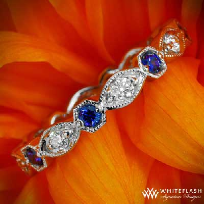 diamond and blue sapphire ring on the flower