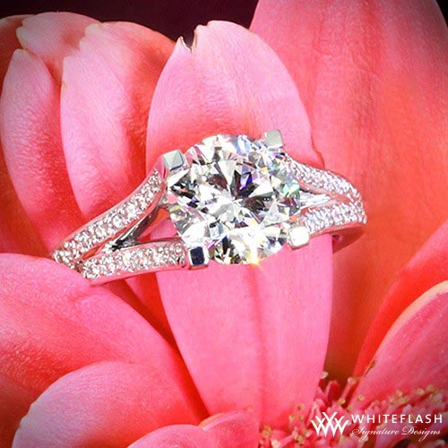 pink flower and engagement ring