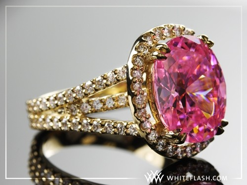 A ring set with a pink sapphire