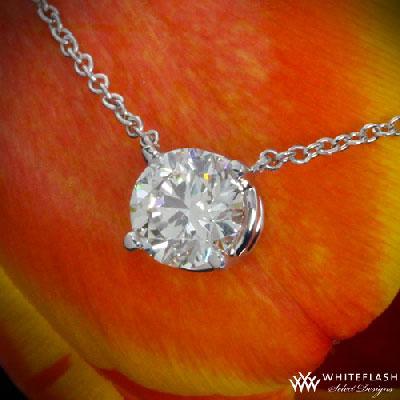 round cut diamond pendant on a flower petal
