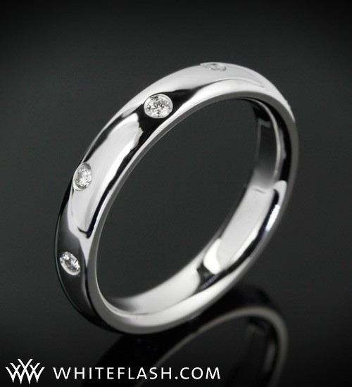 A simple diamond wedding band with scattered diamonds