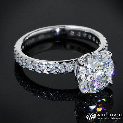 solitaire engagement ring with round cut diamond four prong